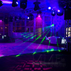 Dance floor complimented by smoke machine, laser lights, and rotating lights to provide exciting and interesting party atmosphere