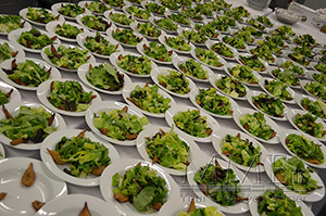 salads displayed at a catered corporate event
