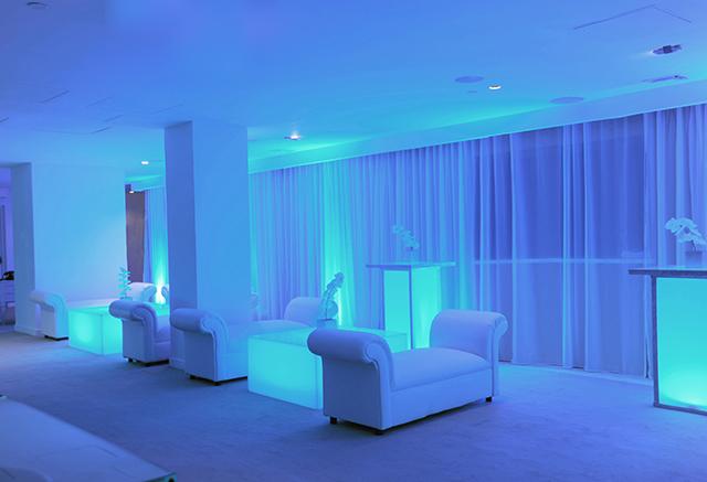 blue lighting white lounge decor