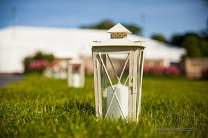 Close up of lantern at outdoor wedding